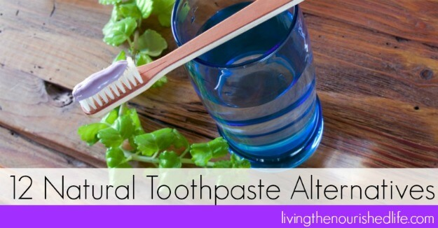 12 Natural Toothpaste Alternatives: a blue cup and a toothbrush
