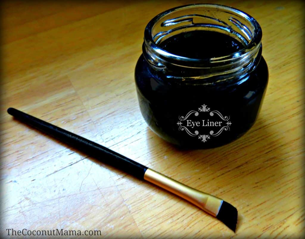 Coconut Oil for Skin: Homemade Eye Liner, with glass jar filled with eye liner ingredients and a makeup brush