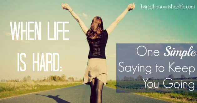 When Life is Hard, One Simple Saying to Keep You Going: Woman with hands up, walking down street