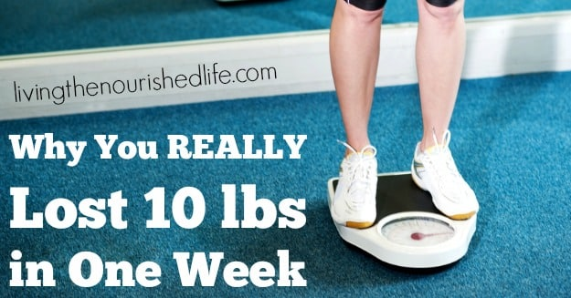 Why You REALLY Lost 10 lbs in One Week: person on weight scale