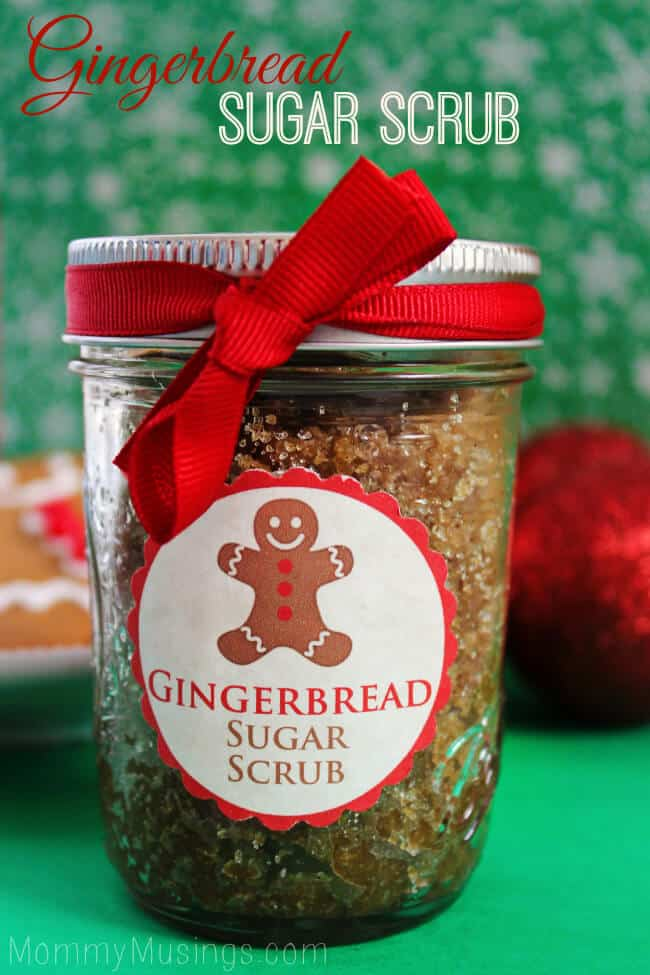 gingerbread sugar scrub in a glass jar with a red bow and a gingerbread man on the label