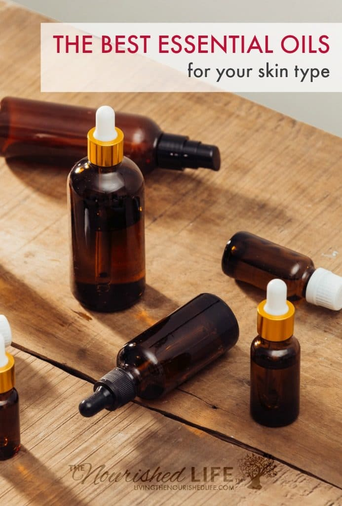 Several amber dropper and pump bottles on a wooden table