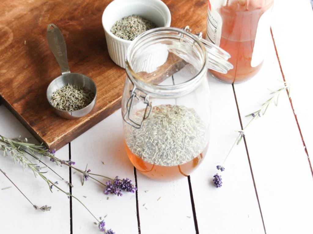 Herbal apple cider hair rinse in a glass jar