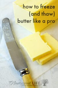Block of butter, cut with bone-handled vintage knife.