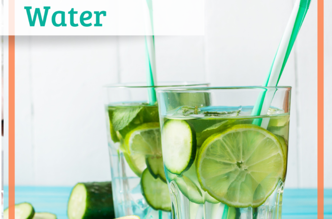 two glasses of cucumber water with straws