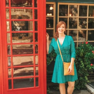a picture of Elizabeth Walling standing next to a red phone booth