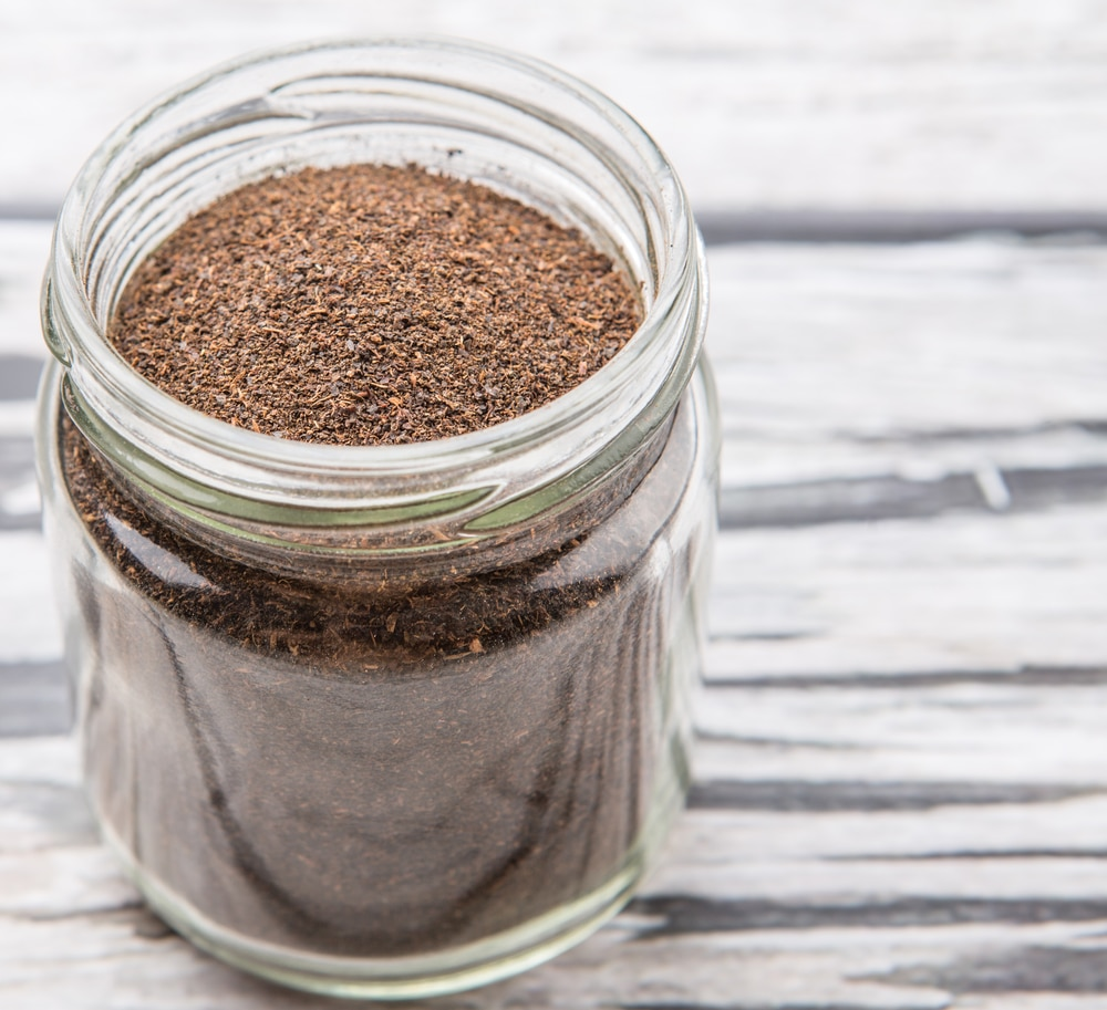 coffee grounds in a glass jar